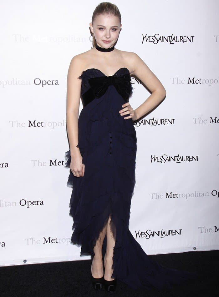 Chloe Moretz in a blue YSL tiered gown at the Metropolitan Opera's premiere of Jules Massenet's 'Manon' held at the Metropolitan Opera House in Lincoln Center in New York City on March 26, 2012