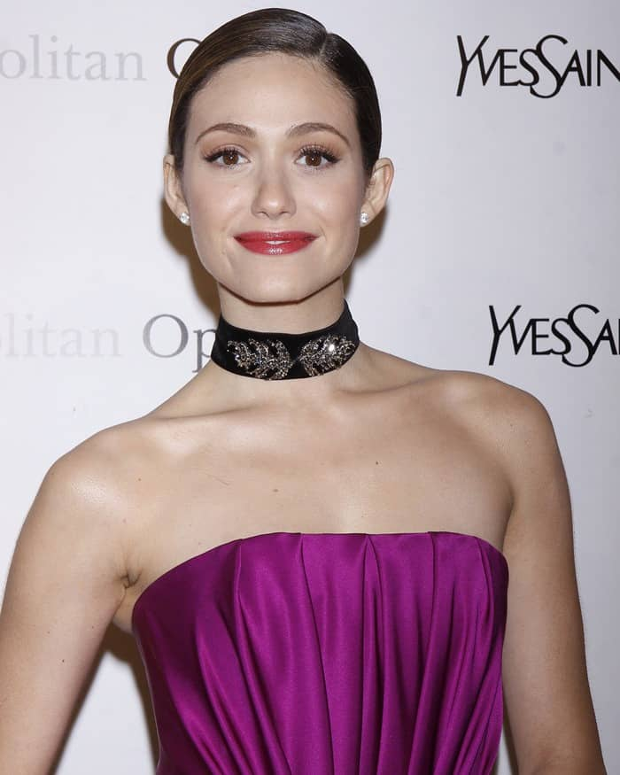 Emmy Rossum in a strapless YSL Edition Soir 12 magenta satin dress at the Metropolitan Opera's premiere of Jules Massenet's 'Manon' held at the Metropolitan Opera House in Lincoln Center in New York City on March 26, 2012