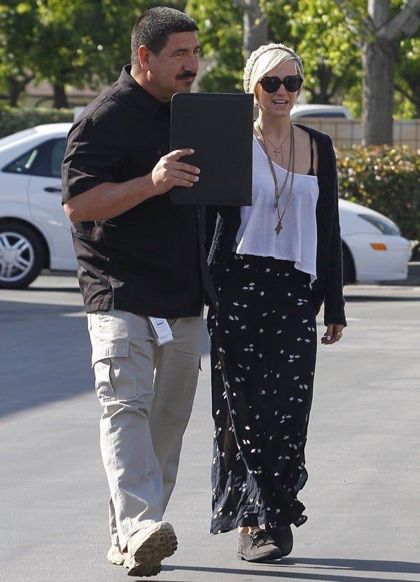 Ashlee Simpson spotted in Los Angeles wearing a layered cross pendant necklace on April 4, 2012