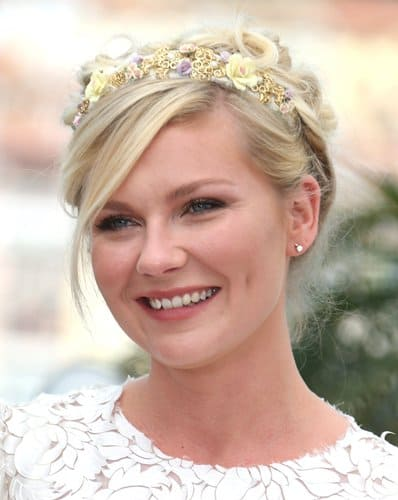 For Kirsten Dunst's first appearance at the 2012 Cannes Film Festival in France, the actress opted for a white D&G dress styled with a bejeweled flower tiara