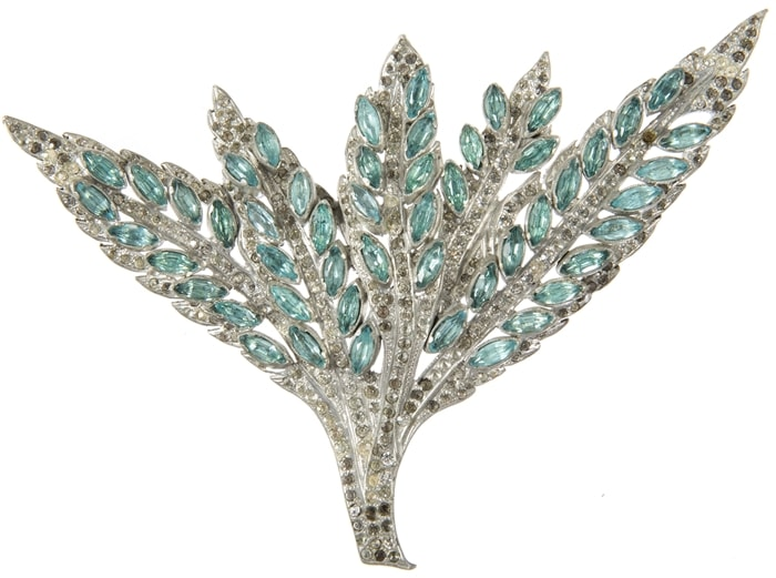 """A simulated diamond and aquamarine costume ornament in foliate design. It was worn by Jean Harlow as a closure for an evening cape in """"Libeled Lady,"""" a 1936 screwball comedy film"""