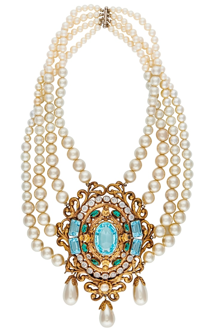 """A graduated, four-strand simulated pearl necklace centering on a gold plated filigree medallion set with simulated aquamarine, emeralds, and diamonds with pearl drops. It was worn by Bette Davis in """"The Virgin Queen,"""" a 1955 DeLuxe Color historical drama film directed by Henry Koster"""