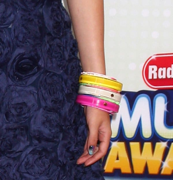 Bella Thorne showing off her bangles by Kate Spade