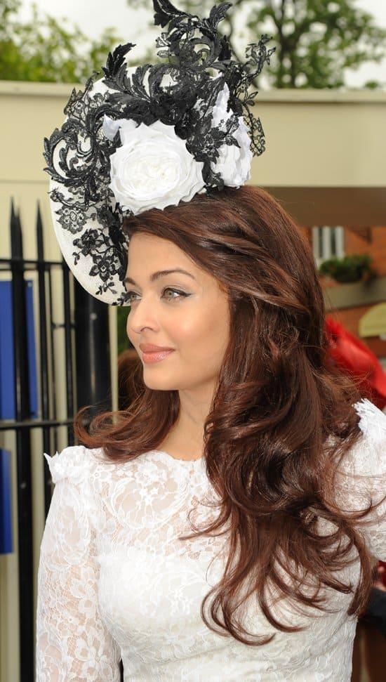 Aishwarya Rai Bachchan channeling Eliza Doolittle in a black-and-white fascinator