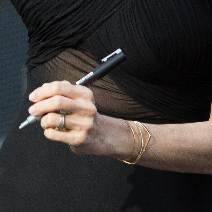 A closer look at Angie's thin gold bangles