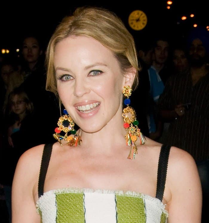 Kylie Minogue styled her striped dress with a fun pair of dream catcher earrings.