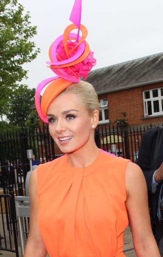 Katherine Jenkins sporting a sculptural fascinator in orange and fuchsia