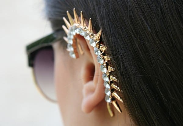Midheta's crystal-embellished ear cuff features gold-tone spikes