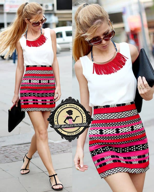 Sirma flaunted her legs in a Zara skirt styled with a white top and a red fringed necklace