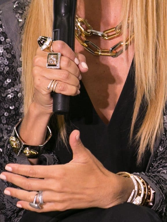 Rachel wore an assortment of jewelry — chunky cuffs, gold chains, and a variety of art deco rings, and almost all are bejeweled with sparkly stones