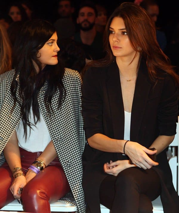 Kylie Jenner with sister Kendall at the Day by Day fashion show in Los Angeles on October 16, 2013