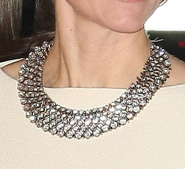 Kate's statement crystal necklace added sparkle to her sophisticated designer gown