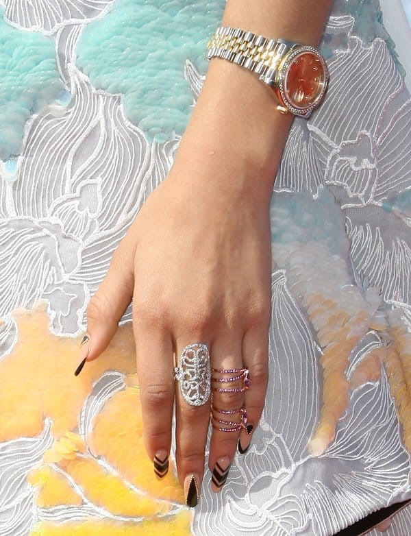 Zendaya decorated her fingers with statement rings of different sizes and colors