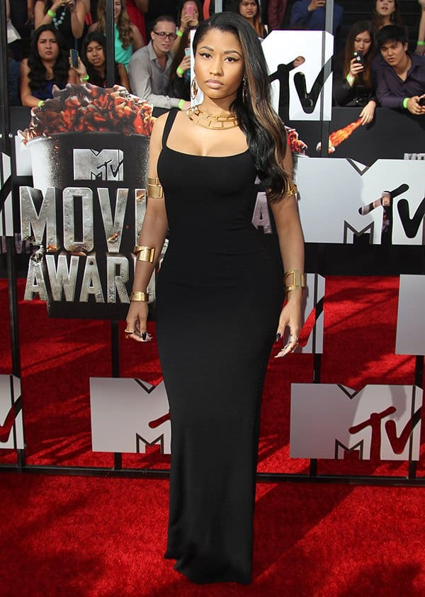 Nicki Minaj wearing a black Alexander McQueen gown that hugged her famous hourglass curves