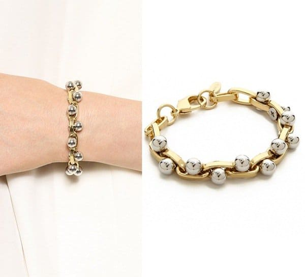 Polished spherical studs jut through sleek links on a Joomi Lim chain bracelet