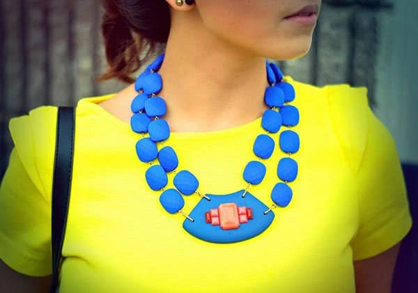 Amparo's cool necklace matched well with her neon yellow top