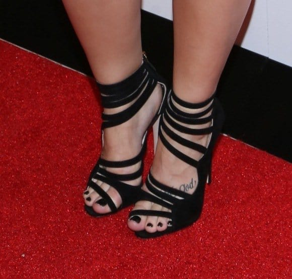 Demi Lovato completed her ensemble with Miu Miu strappy sandals