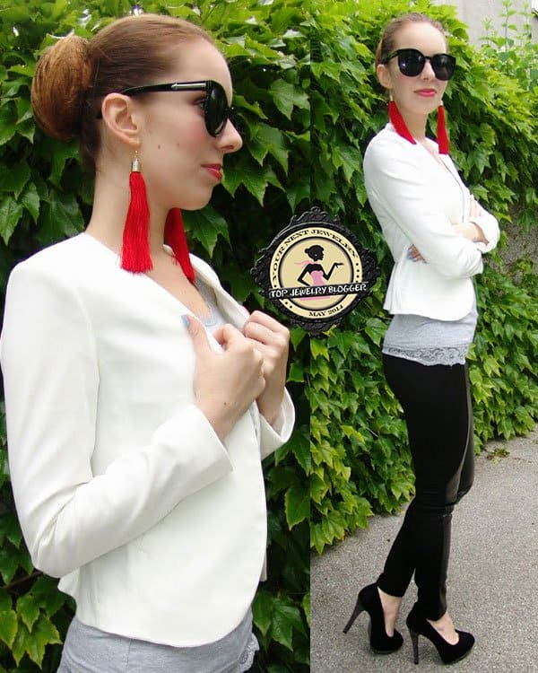 Katja added color to her monochrome outfit with red tassel earrings
