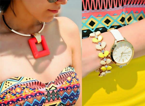 Paris accessorized with a yellow diamond bracelet and a luxurious watch