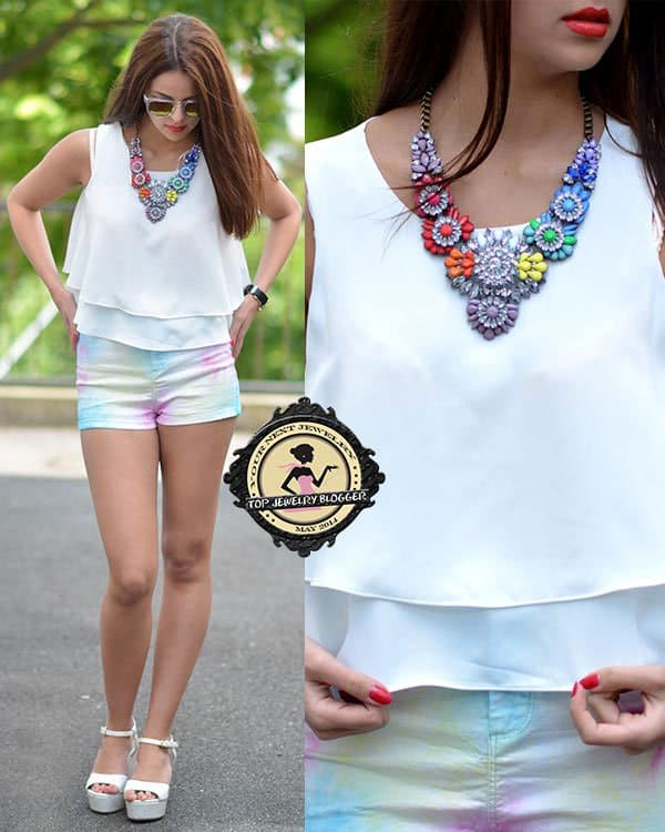 Saskia styled her white shirt with a rainbow-colored crystal necklace