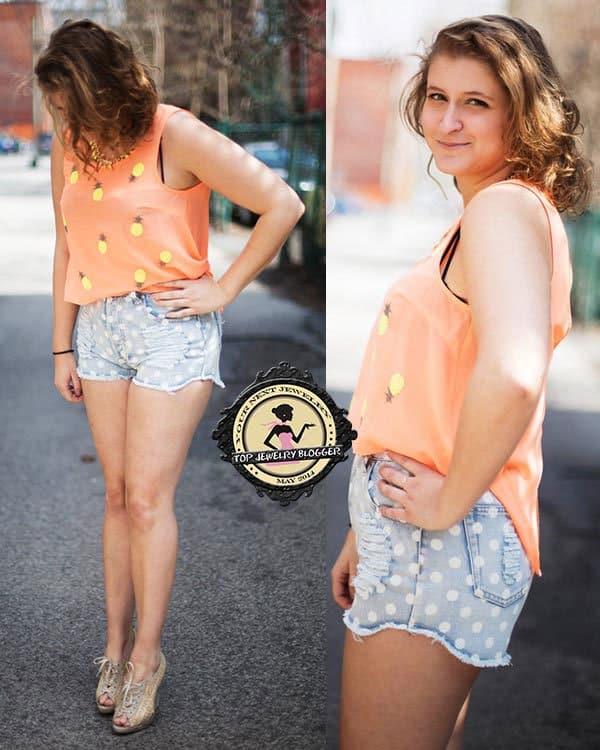 Virginie flaunts her legs in polka-dot denim shorts styled with an orange pineapple-printed sleeveless top