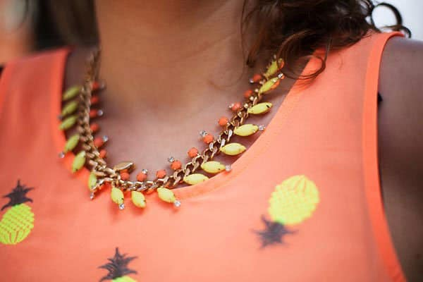 Virginie's necklace featuring yellow and orange stones
