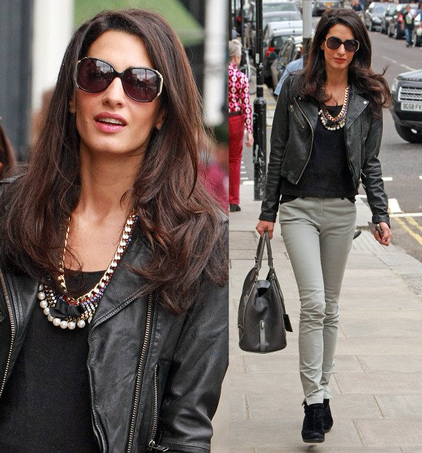 Alamuddin wearing an elegant statement necklace made of colorful stones and pearls
