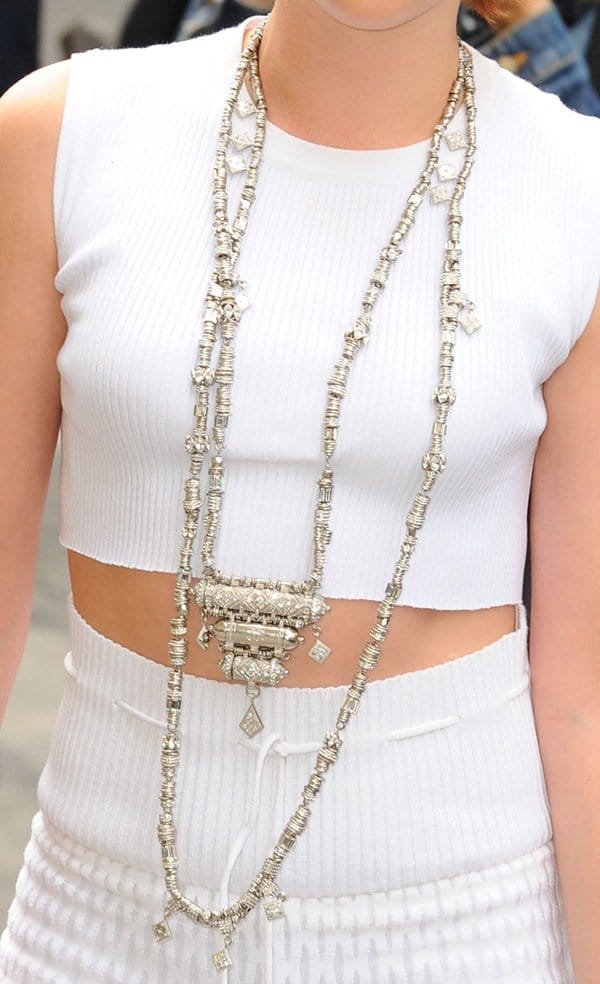 Kristen Stewart styled her all-white ensemble with a long and heavy-looking silver necklace
