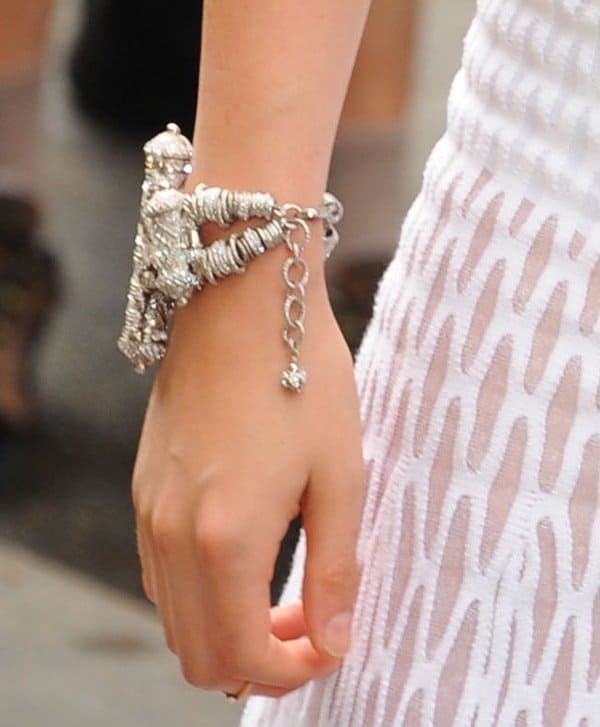 Kristen Stewart styled her all-white ensemble with silver bracelets