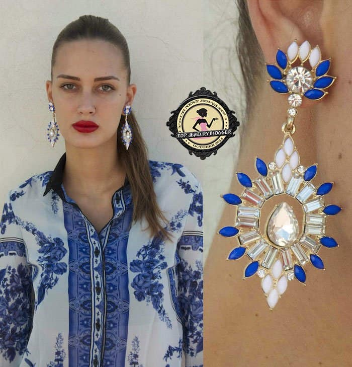 Amina styled a white-and-blue button-down shirt with crystal earrings