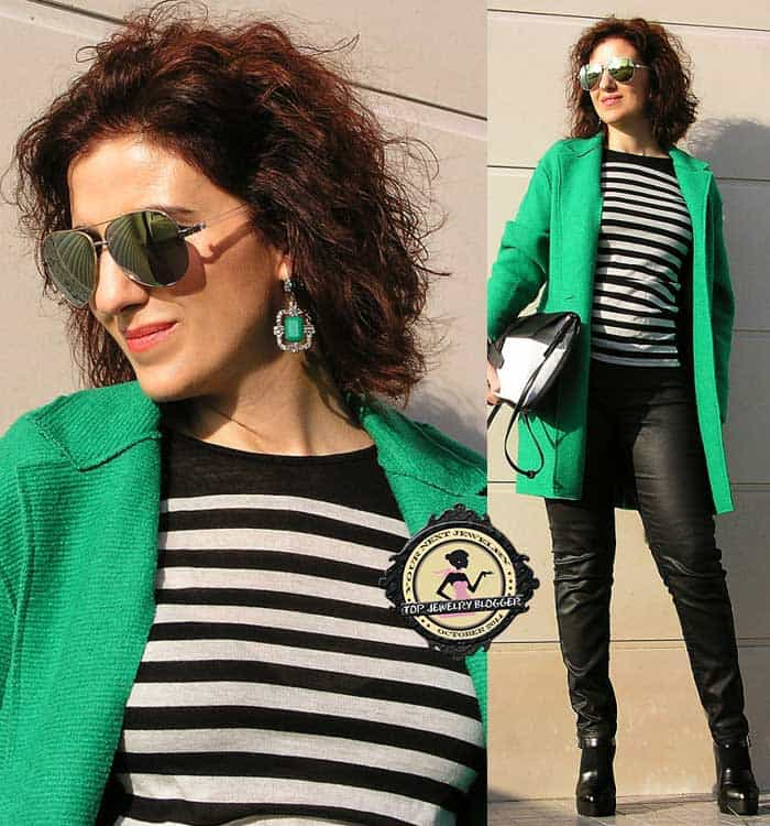 Tanya styled a striped top with a green coat and matching earrings