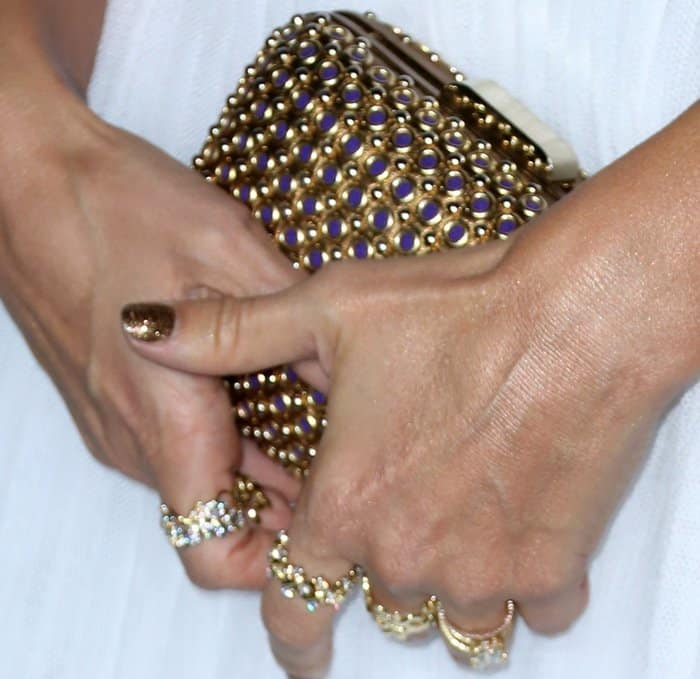 "Jessica Alba carried a Brian Atwood ""Lory"" clutch that matched the metallic look of her outfit"