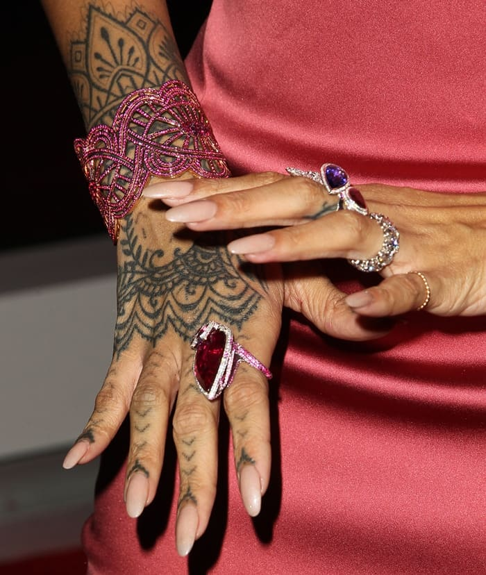 Rihanna added matching rings and an intricate ruby cuff around her tattooed wrist