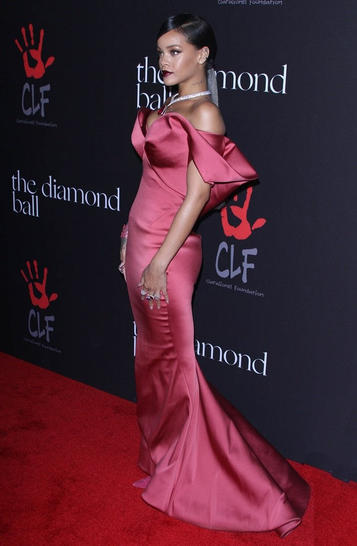 Rihanna wearing a very elegant Zac Posen Fall 2014 gown in a dramatic deep rose hue