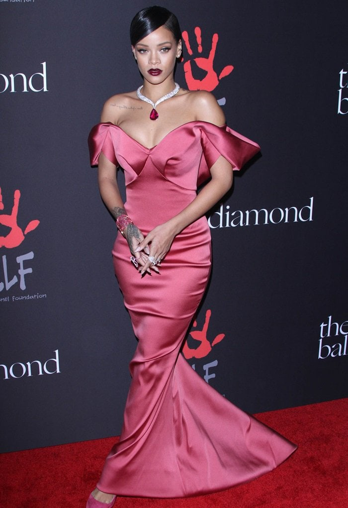Rihanna's off-shoulder number features bold shoulders, a short train, and a lovely pleated detail