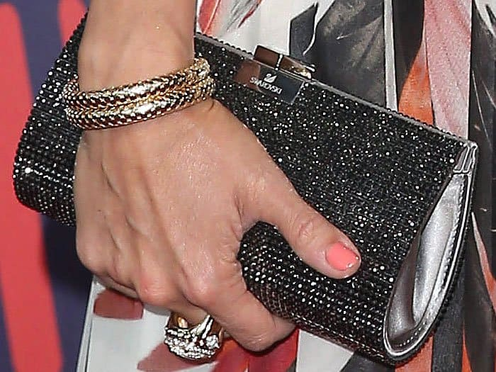 "Closeup of Carrie Underwood's John Hardy bracelet, cuff ring, and Swarovski ""New Power"" crystal clutch"