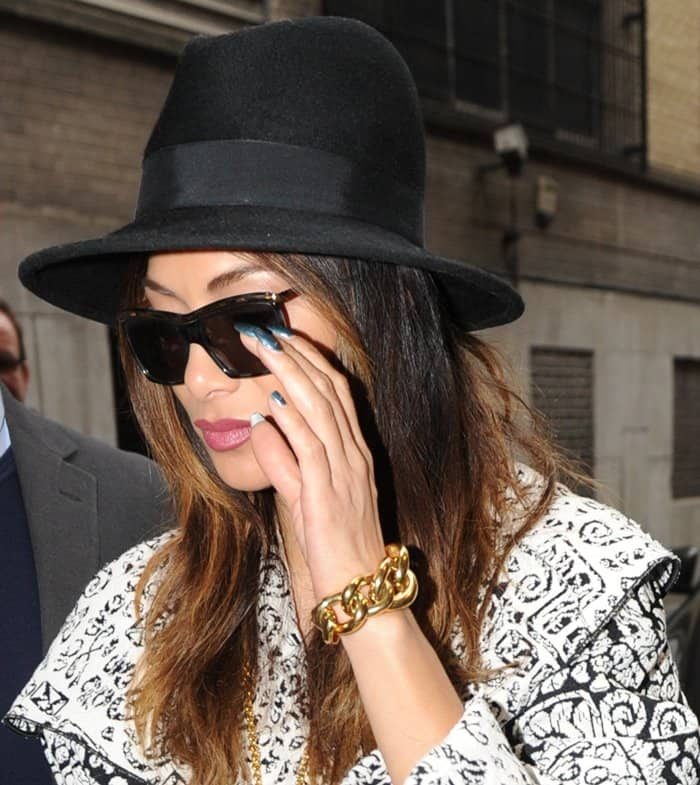 Nicole Scherzinger wearing Chanel gold jewelry