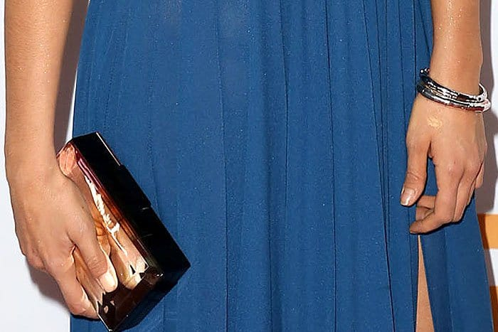 Nina Dobrev carrying a Rauwolf mirror clutch and wearing John Hardy Bamboo Collection bracelets
