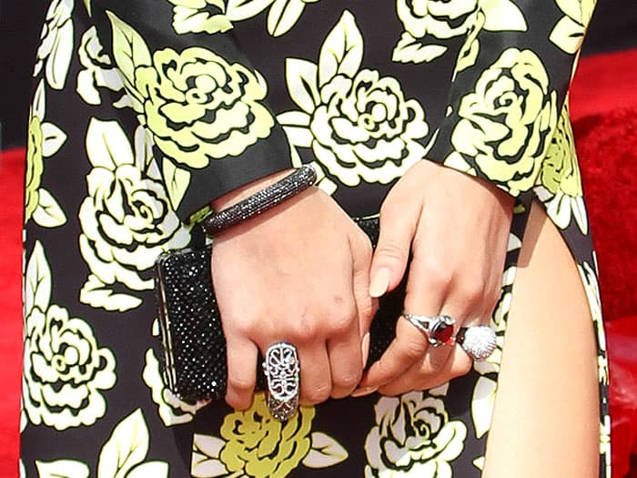 A selection of John Hardy rings and a black Swarovski clutch on Zendaya Coleman