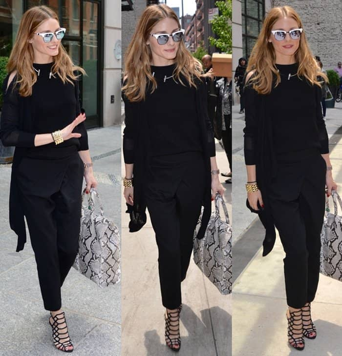 Olivia Palermo wearing a super chic all-black ensemble while entering her hotel