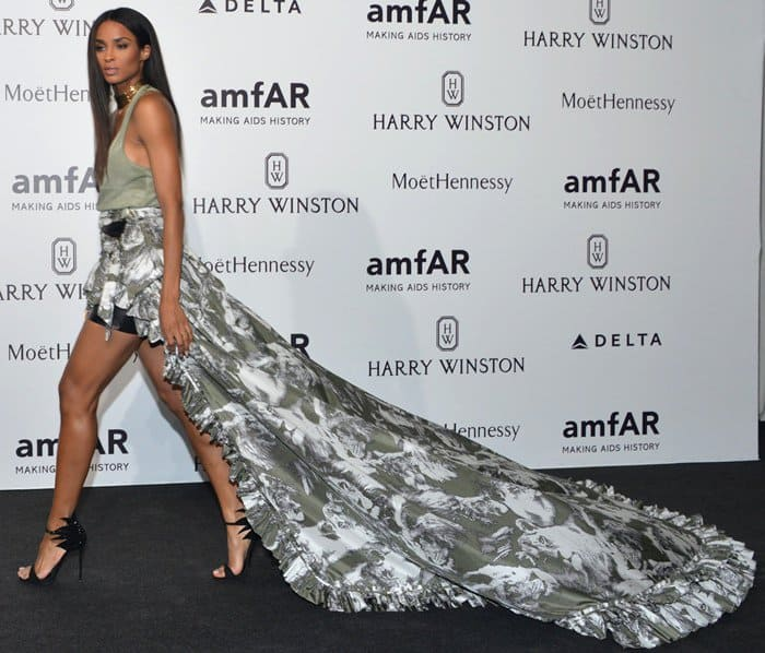 Ciara wowed the crowd at the amfAR Milano Gala in a stunning Roberto Cavalli ensemble that featured a dramatic high-low skirt with a very long train