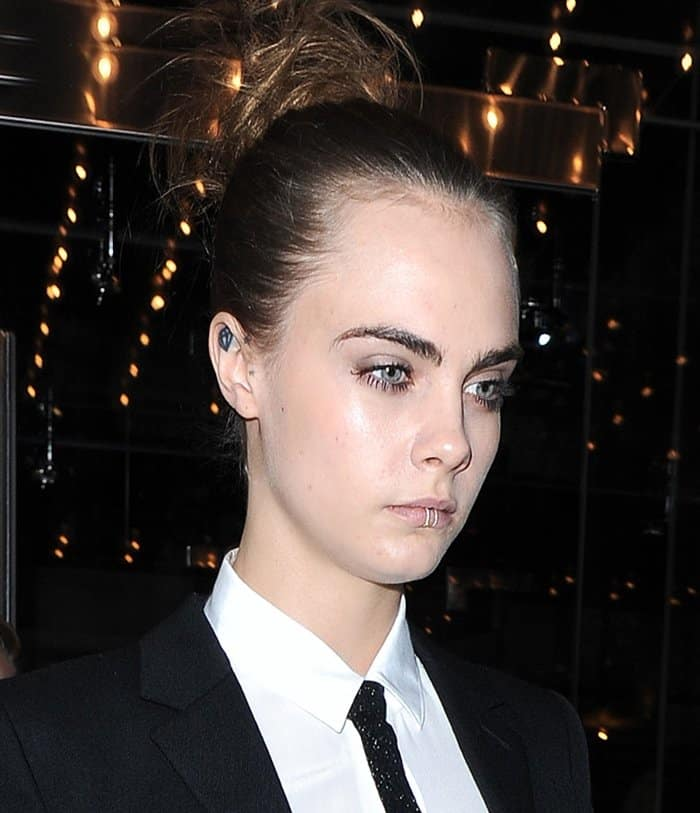 Cara Delevingne wearing not one but two lip rings