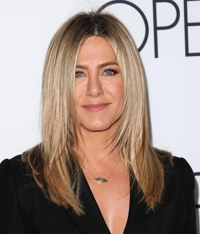 Jennifer Aniston wearing a necklace from the 3rd Eye Collection of Amrit Jewelry