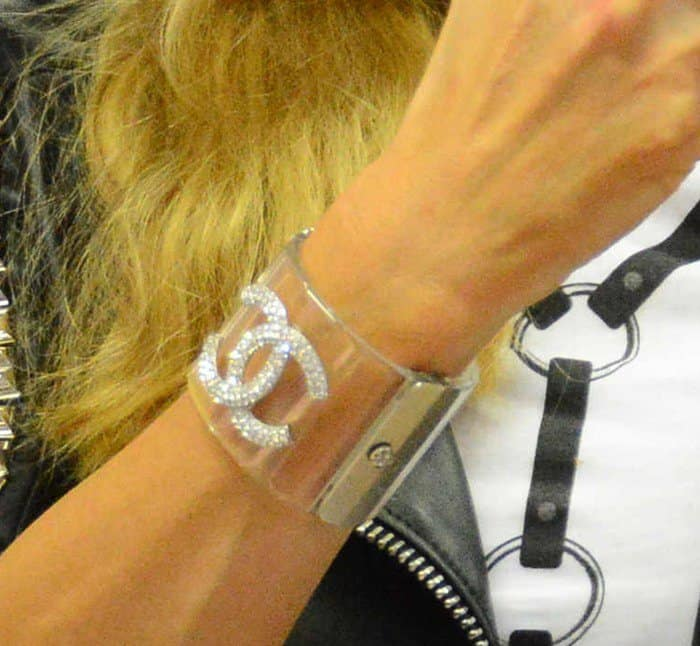 Paris Hilton wore a Chanel lucite cuff on her wrist