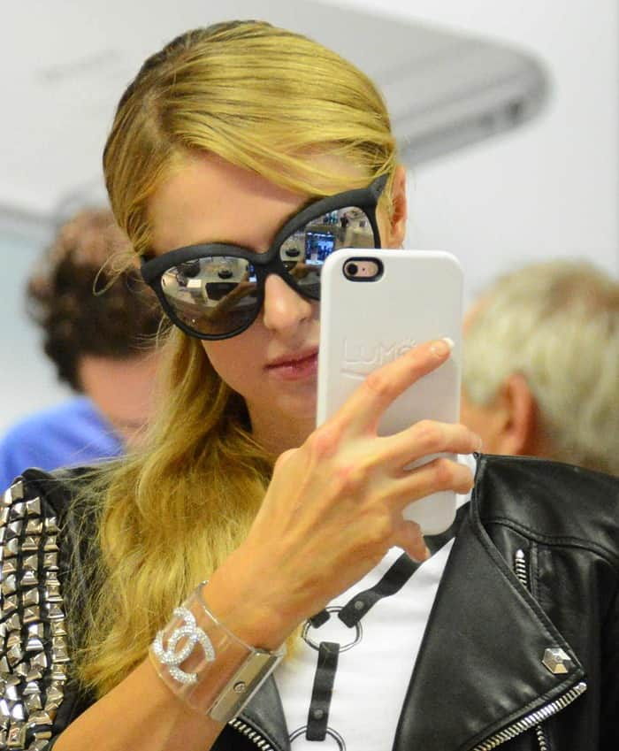 Paris Hilton wears sunglasses from Italia Independent