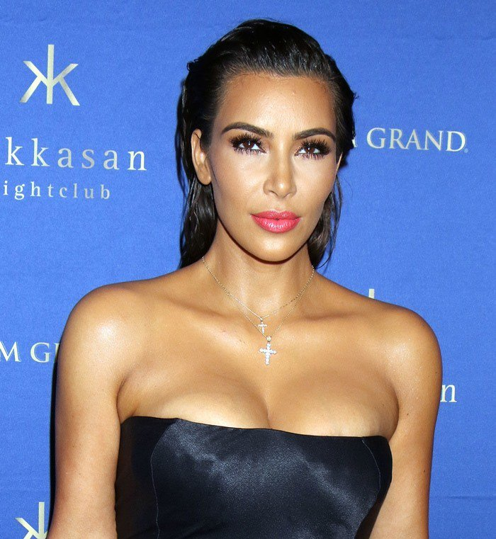 Kim Kardashian in a strapless silky dress that revealed her ample cleavage