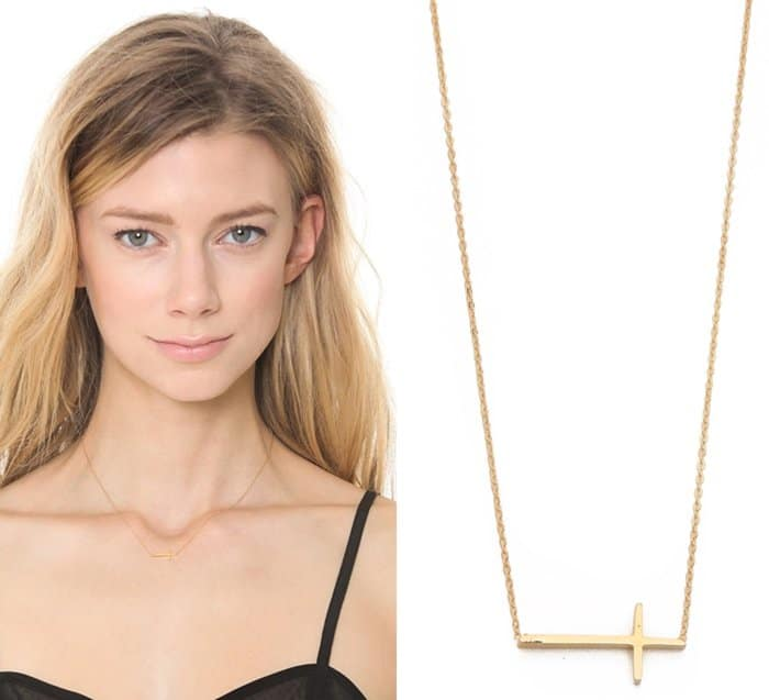 A slim cross is suspended from fine chain on a delicate Tai necklace