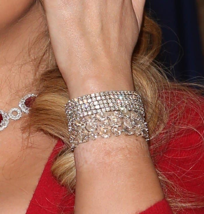 Mariah Carey wearing sparkling bracelets on both wrists