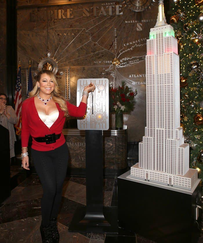 Mariah Carey switches on the Empire State Building's Christmas lights in New York on December 6, 2016