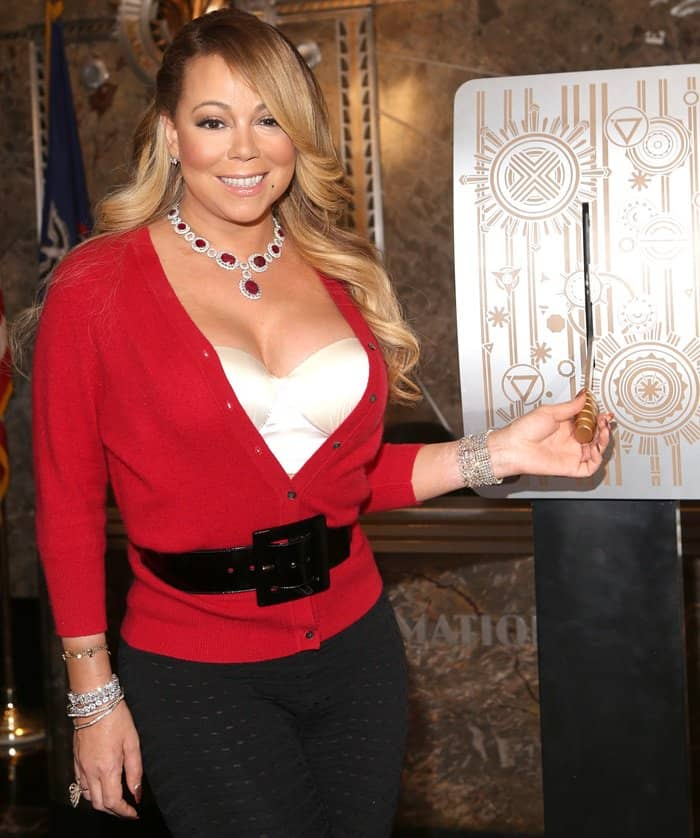 This diva added major glam to her ensemble with a chunky layering of sparkling bracelets on both wrists, solitaire diamond earrings and a stunning ruby necklace
